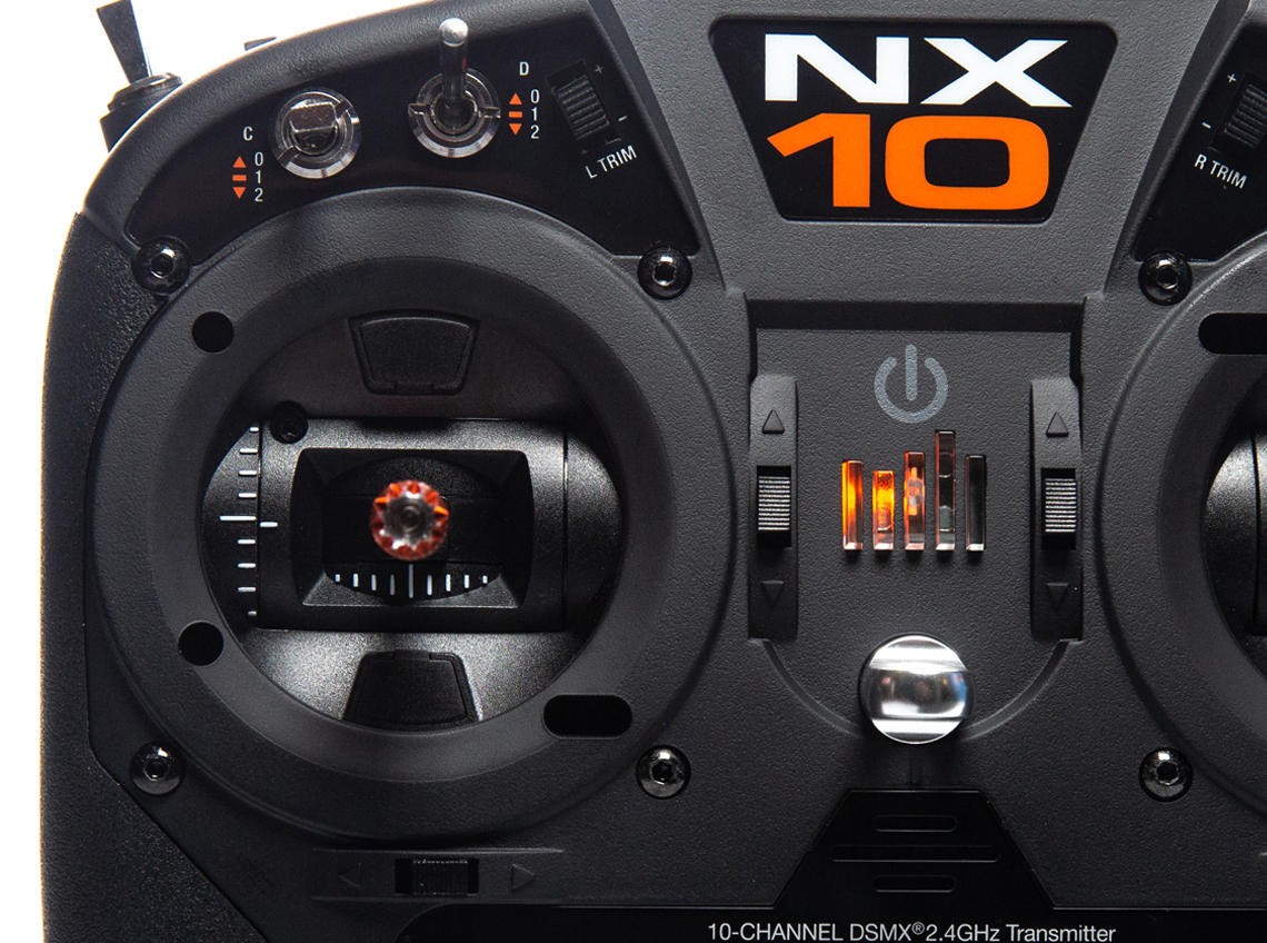 An NX10 photo depicting the transmitter gimbles and front-facing switches.